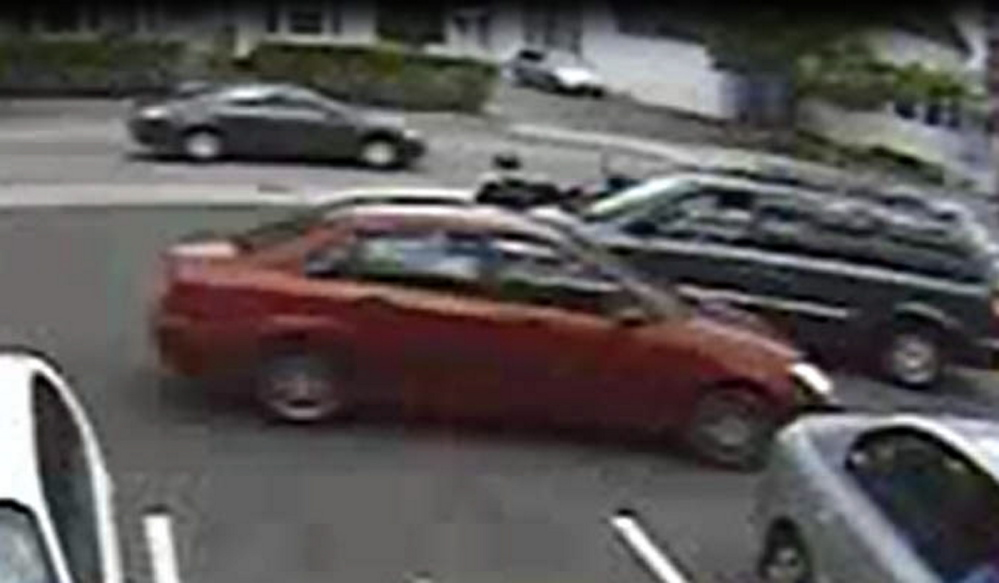 The woman who is believed to have taken a donation jar from Dunkin' Donuts was driving this maroon sedan.