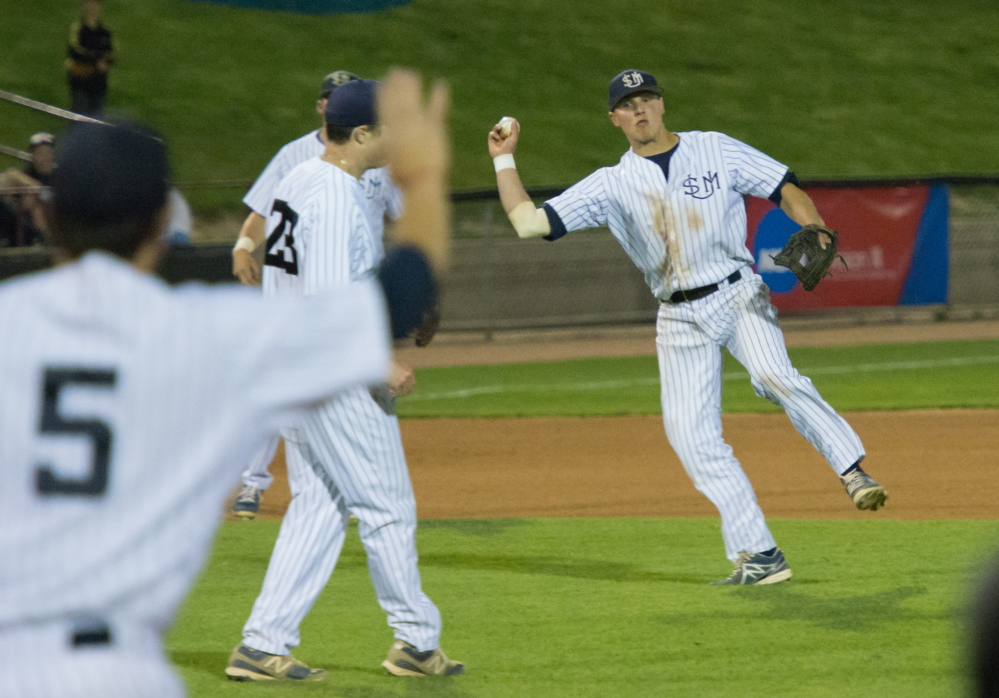 University of Southern Maine shortstop Sam Dexter holds his throw after fielding a ball that deflected off pitcher Alex Tobey during the seventh inning of an 8-1 loss to Wisconsin-Whitewater in the NCAA Division III championships Friday night at Appleton, Wis.
