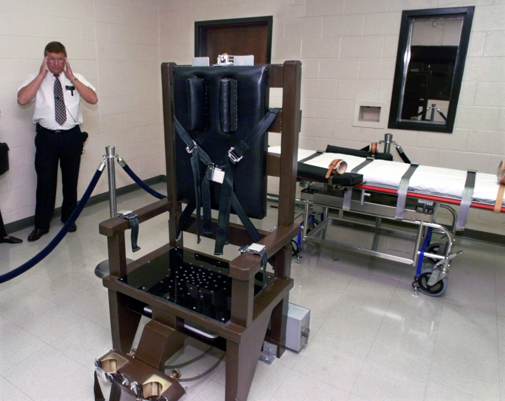 Ricky Bell, then warden at Riverbend Maximum Security Institution in Nashville, Tenn., gives a tour of the execution chamber in 1999. Gov. Bill Haslam signed a bill into law on Thursday allowing electrocution if drugs for lethal injection cannot be obtained.
