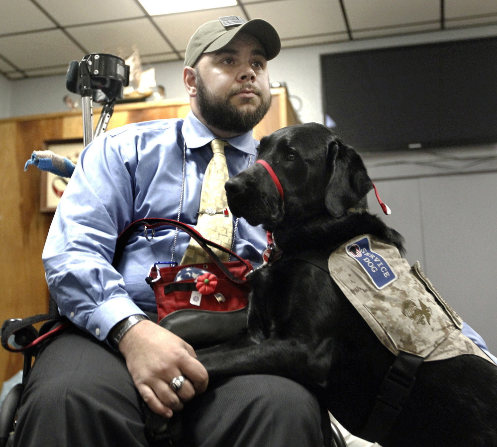 Former U.S. Marine Ryan Bugler and his Labrador retriever service dog, Noonan, attend a ceremony at the Oakville VFW Post 7330 in Watertown, Conn.