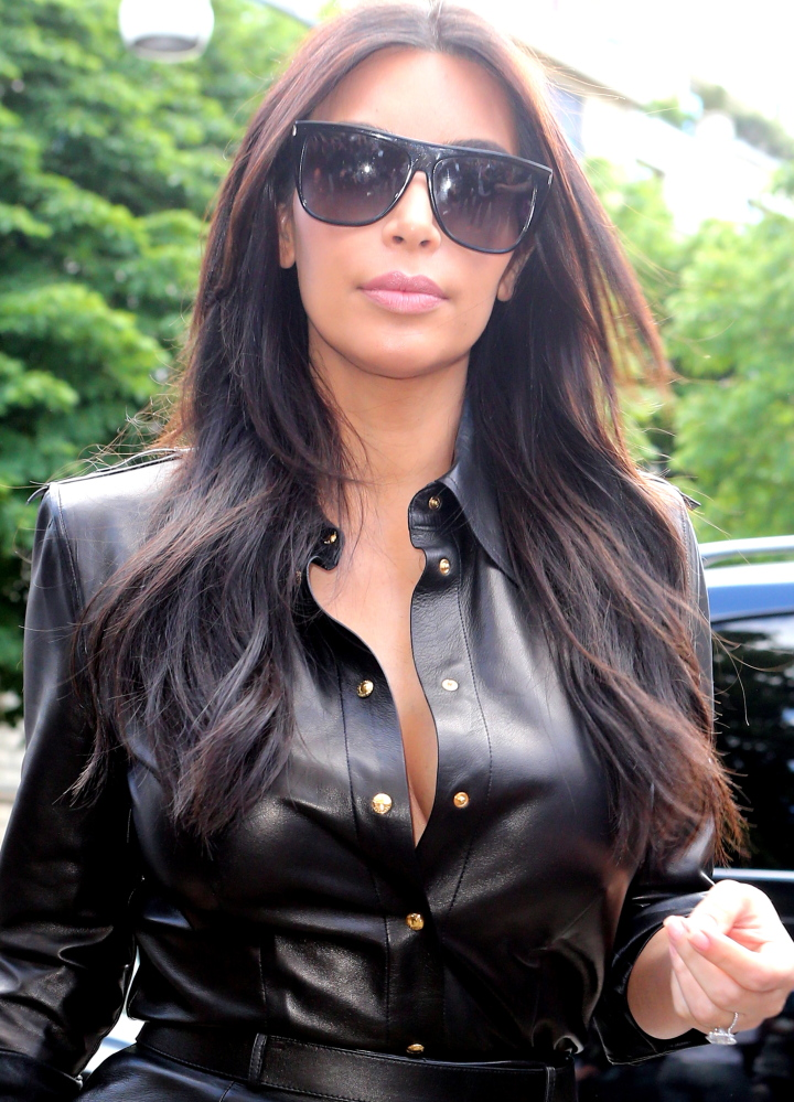 Kim Kardashian arrives at a Paris restaurant on Thursday. She wed singer Kanye West in Florence, Italy on Saturday.