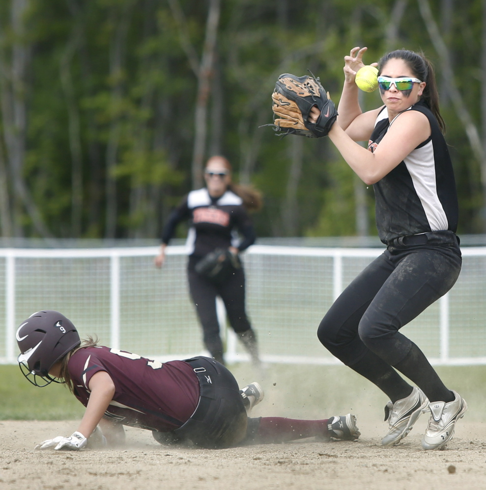 Biddeford shortstop Brittany Roy can't maintain control of the ball while trying to turn a double play after forcing out Morgan Dube of Thornton Academy. Biddeford had its six-game winning streak broken.