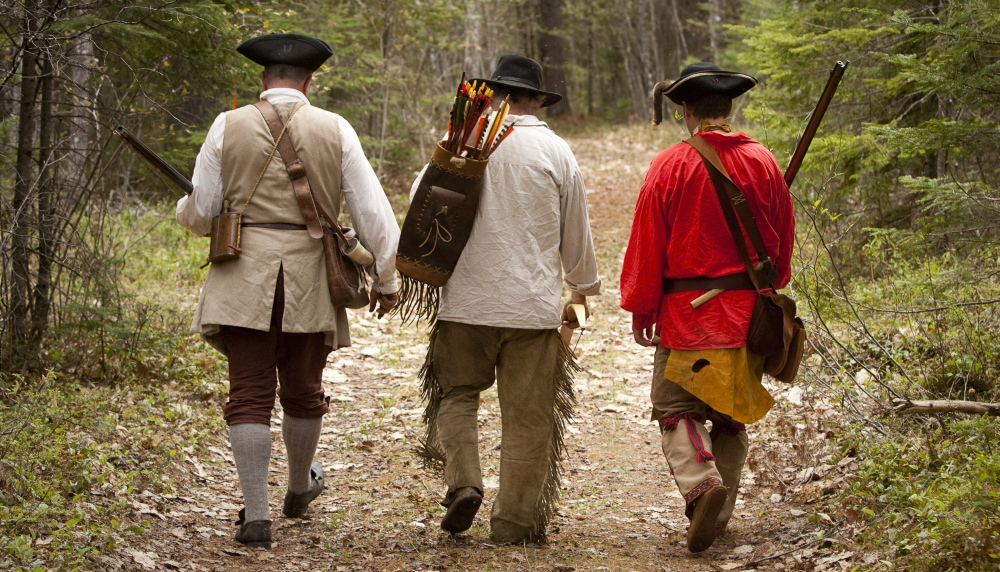 The three amigos? Well you can call them that – a trio of Ancient Ones who dress the part while walking in the woods during a rendezvous in Canton.