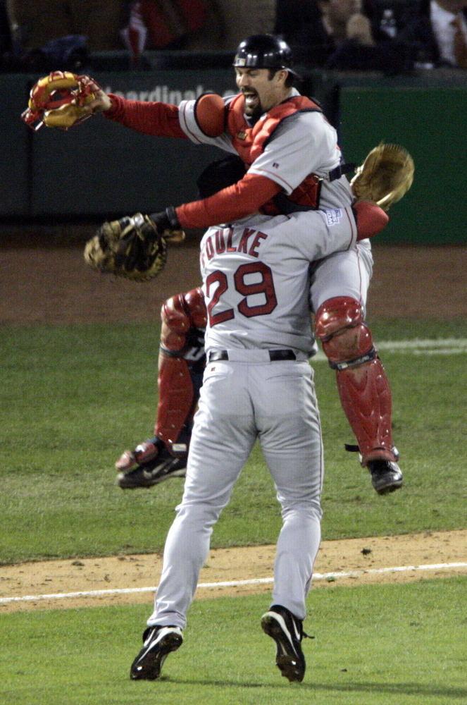 In what has become an iconic image of the first World Series victory for the Boston Red Sox in 86 years, pitcher Keith Foulke and catcher Jason Varitek celebrate the team's sweep over the St. Louis Cardinals on Oct. 27, 2004, in St. Louis.