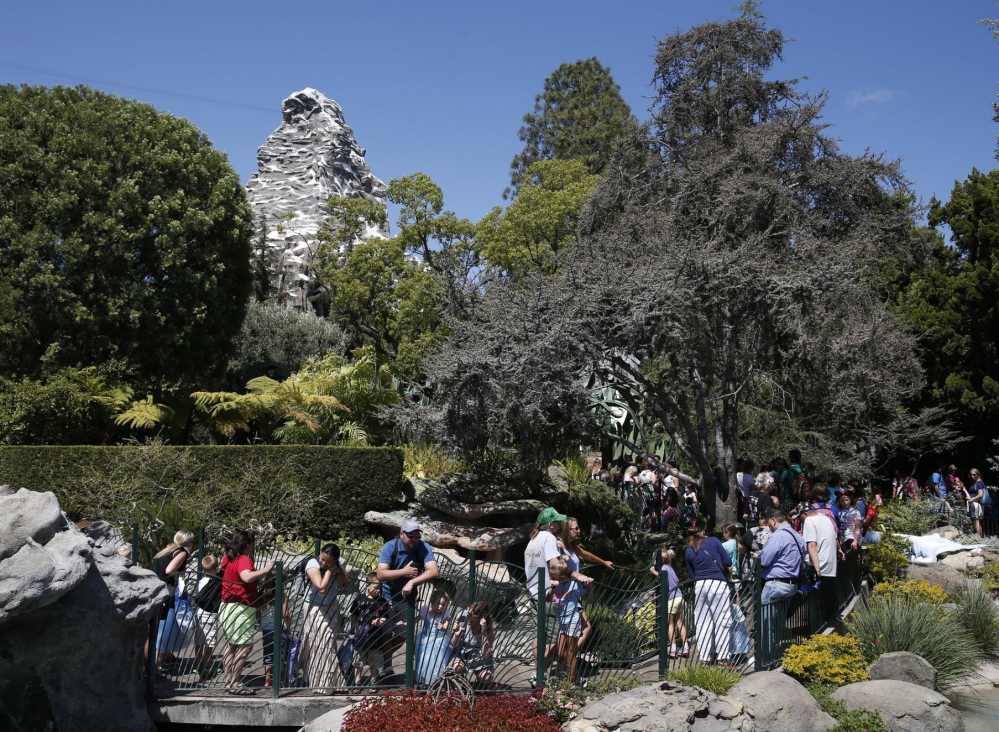 "Patrons stand in long lines at Disneyland. ""Our goal is to always provide the best possible experience for all of our guests,"" said Disneyland spokeswoman Suzi Brown."