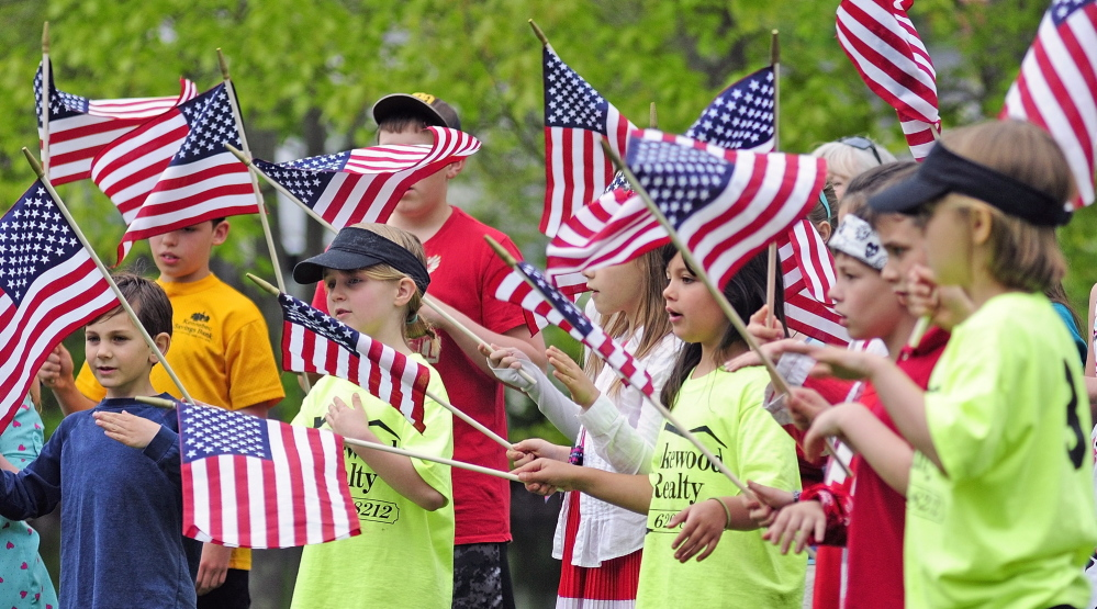 "Wayne Elementary School students sing ""You're a Grand Old Flag"" during Memorial Day events on Monday in Wayne. They learned the song from Bonnie Wilder of the Daughters of the American Revolution Koussinoc chapter."