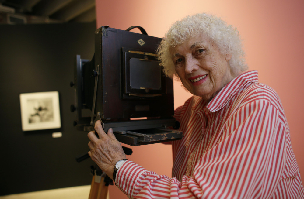 Bunny Yeager poses in April 2013 with a camera similar to one used when she worked as a photographer in the 1950s and '60s at the Bunny Yeager Studio in Miami.