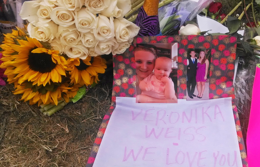 Flowers, photos and a note adorn a sidewalk memorial for a victim of a shooting rampage outside the Delta Phi sorority house in Goleta, Calif., Monday.