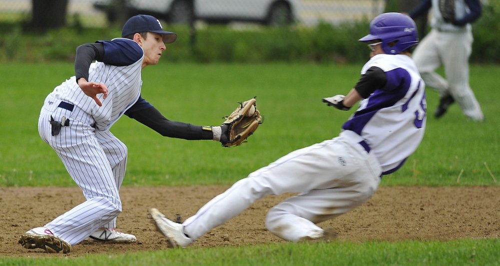Patrick Viola of Deering slides safely into second base as Portland second baseman Evan Gallant attempts to get the tag down in time. Gallant had a two-run single for Portland.