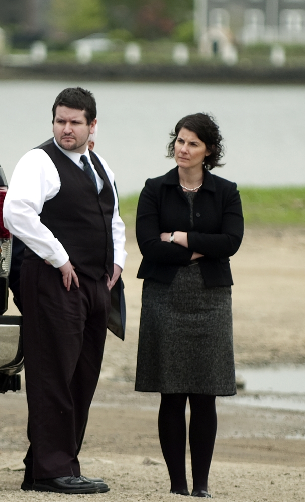 """Defense attorney Melissa Davis stands by defendant Seth Mazzaglia as they wait for jurors to arrive at Peirce Island in Portsmouth, N.H., on Tuesday to view the location where prosecutors allege Mazzaglia disposed of the body of University of New Hampshire student Elizabeth """"Lizzy"""" Marriott."""