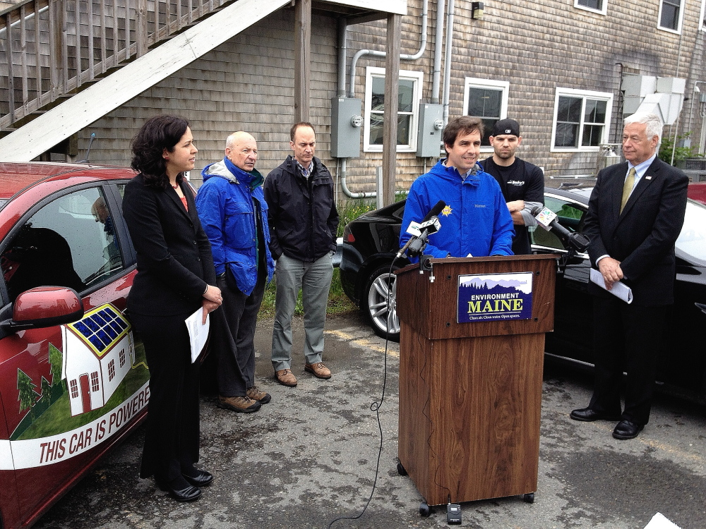 Phil Coupe, co-founder of ReVision Energy, speaks about the benefits of solar energy at a news conference Tuesday at Becky's Diner in Portland. Other participants are, from left, Emily Figdor of Environment Maine, who ran the event, Portland Mayor Michael Brennan, developer Tim Soley, Zach Rand of Becky's and U.S. Rep. Mike Michaud, D-Maine.