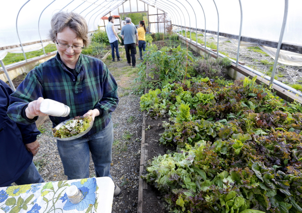TURNER, ME - MAY 21: Jean Meike of Auburn dresses her salad during a