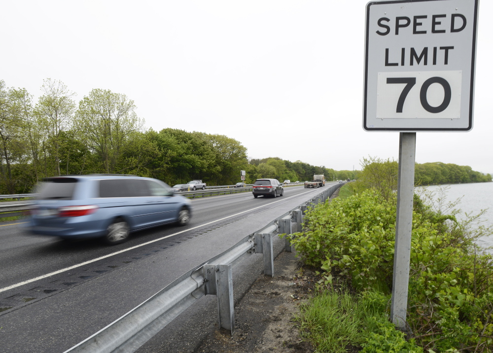 A new 70-mph speed limit sign is posted on the northbound side of Interstate 295 after Tukey's Bridge in Portland. Effective Tuesday, the speed limit increased by 5 mph on I-295 north of Tukey's Bridge to mile marker 51 in Gardiner, which is most of the highway.