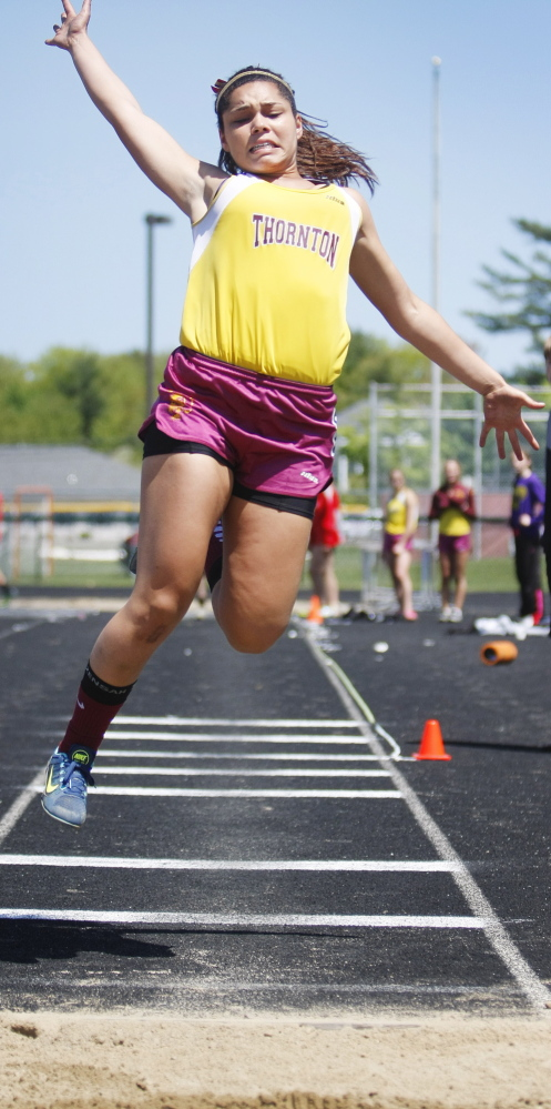 Alex Pettaway led a 1-2-5-6 finish for Thornton Academy in the triple jump, winning with a distance of 34-2 to help the Trojans capture the SMAA girls' team title.