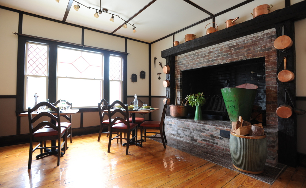 The center piece of the Ironbound Inn, a sister business to Sullivan Harbor Farm Smokehouse, is its fireplace. Co-founder of the smokehouse, Leslie Harlow, plans to offer salmon smoking courses from the Ironbound which sits two buildings away from the smokehouse. Photo/Kevin Bennett