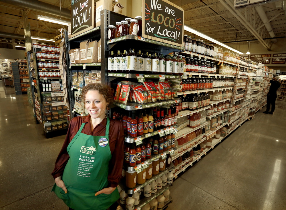 Kristen Bartlett, among some of the local products Whole Foods in Portland carries. Tim Greenway/Staff Photographer