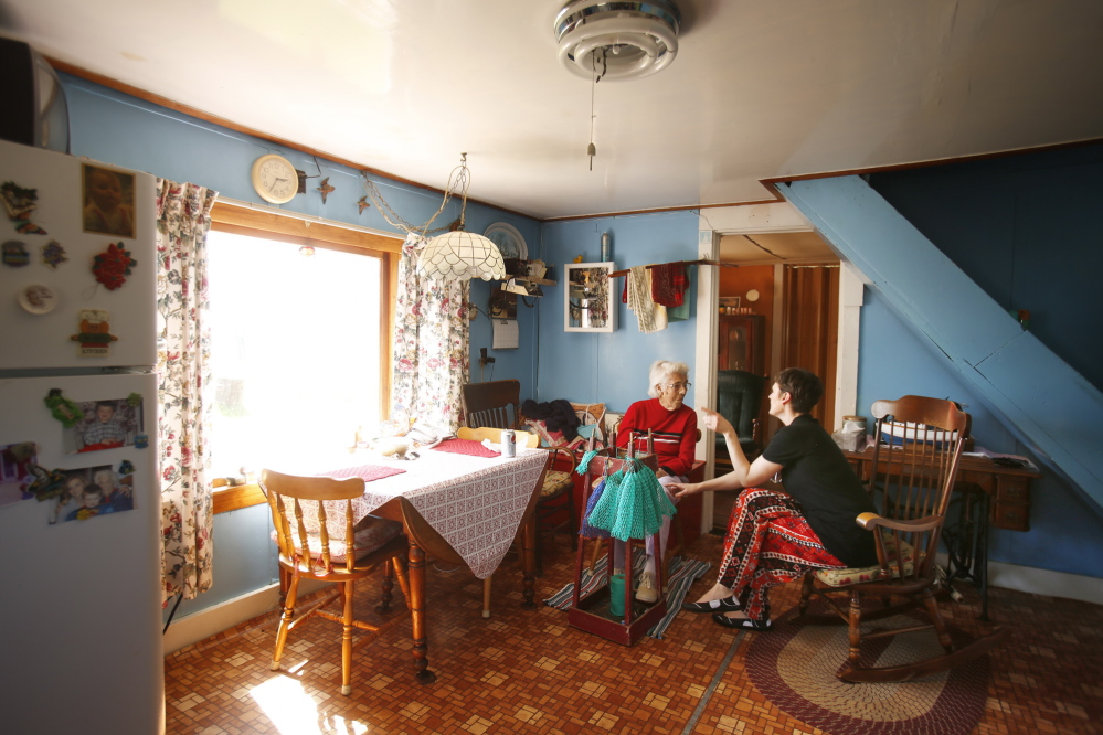 "Nurse practitioner Jennifer Desmond talks with Ruth Ames, 97, at Ames' home on Vinalhaven, an island 75 minutes from Rockland by ferry. ""Every time I see her number on caller ID, I think, 'Oh no, what's wrong with Ruth?' "" Desmond said. ""She usually is just calling to tell me that she picked crab that morning."""
