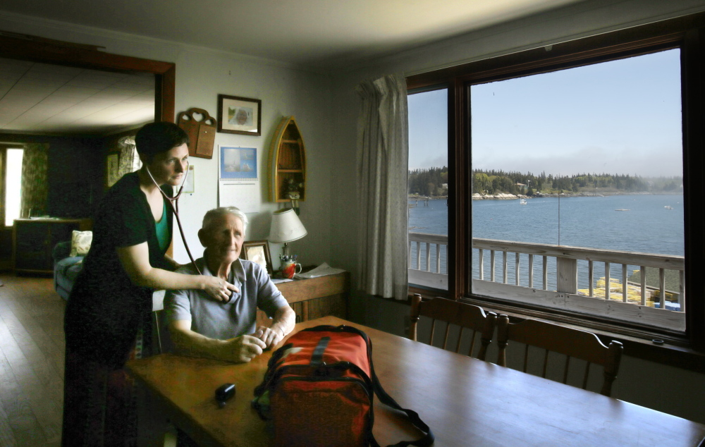 "Nurse practitioner Jennifer Desmond checks on Harold ""Sonny"" Warren at his home on Vinalhaven. Desmond ""is the best thing to ever happen to Vinalhaven,"" the 86-year-old lobsterman said. ""She's stuck with us night and day. Six of the other doctors left."" Photos by Gregory Rec/Staff Photographer"