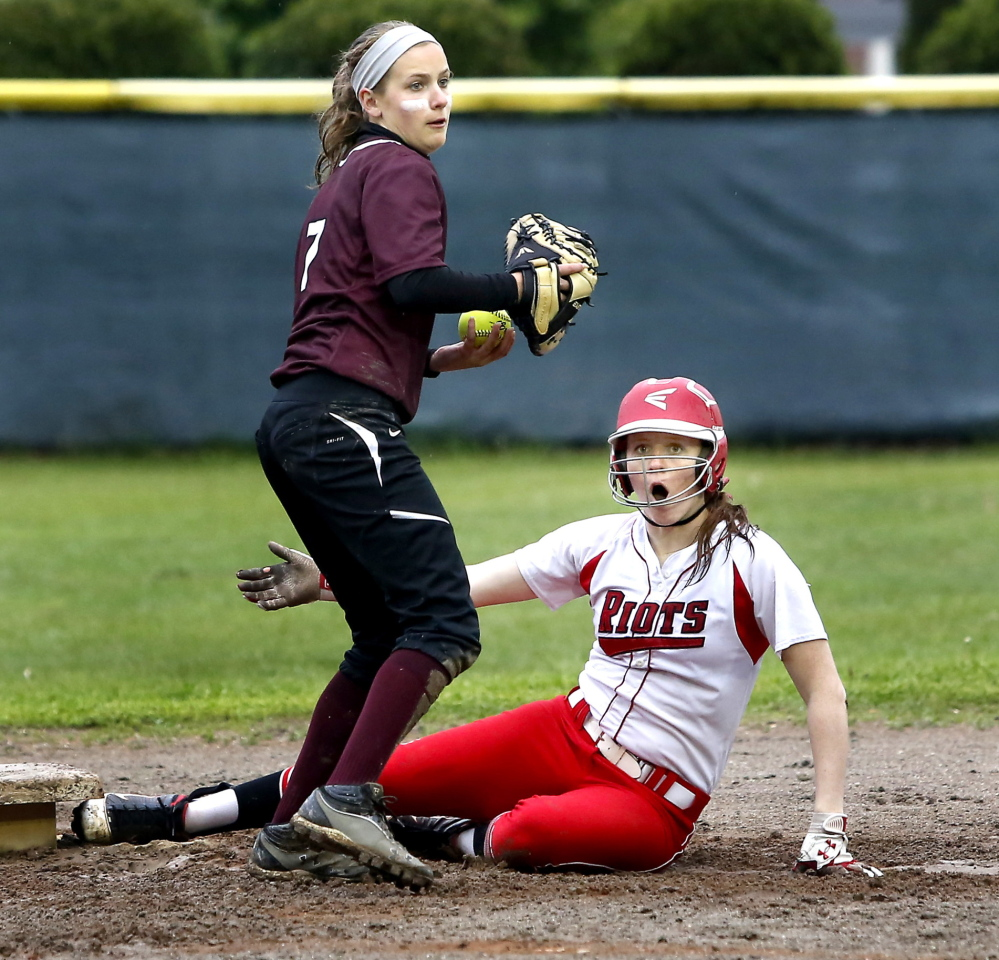 Sarah Micucci of South Portland can't believe the out call at second base as Emily DeLuca of Gorham prepares to throw the ball during Friday's SMAA softball game in Gorham. South Portland won, 15-9. Photos by Tim Greenway/Staff Photographer