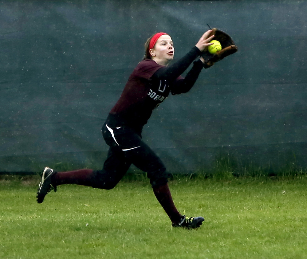 Courtney Roberts makes a running catch for Gorham, which couldn't hold on to a late lead against South Portland.