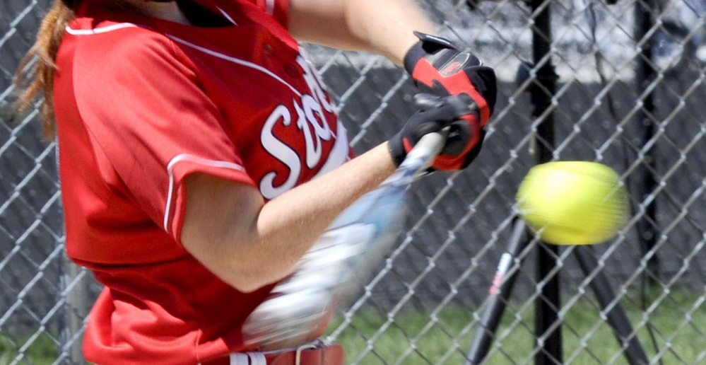 Before 2010, when a rule change moved the high school softball pitching rubber from 40 to 43 feet, hitting had become a lost art. But now fielding has become a factor because when the bat moves toward the ball, it's now much more apt to make contact. File photo by John Patriquin/Staff Photographer