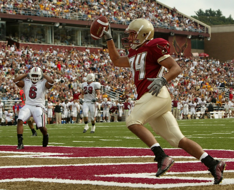 In this 2004 file photo, a Boston College football celebrates at touchdown at Alumni Stadium in Chestnut Hill, Mass. A city councilor has proposed a bill that would prevent Boston's schools from revoking scholarships when athletes are injured or otherwise fall out of favor with coaches.