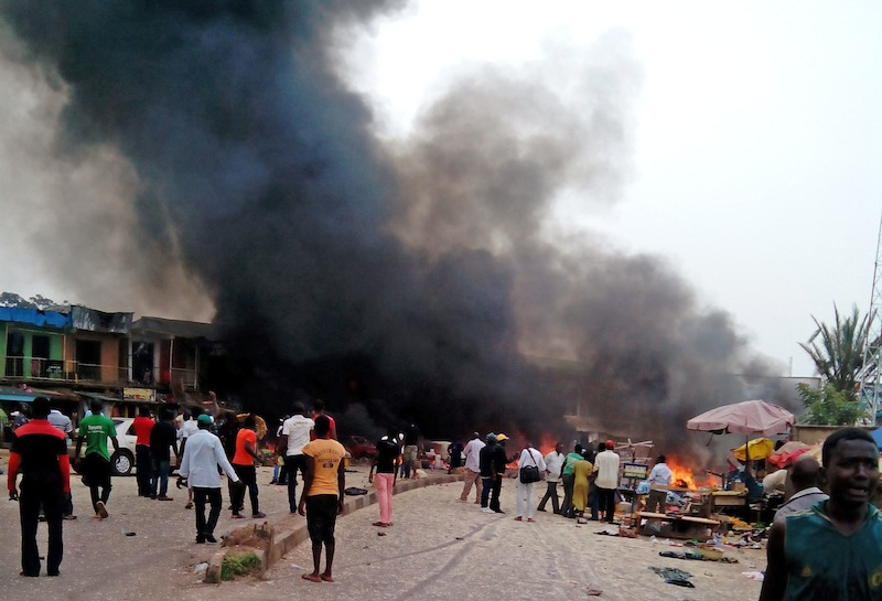 Smoke rises after a bomb blast at a bus terminal in Jos, Nigeria, Tuesday.