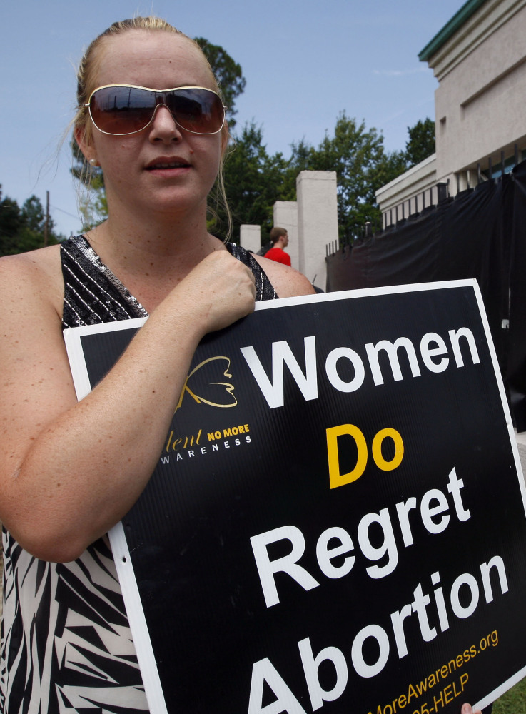 Ashley Sigrest of Brandon, Miss., protests abortion in 2012. New laws on hospital admitting may limit access to the procedure. The Associated Press