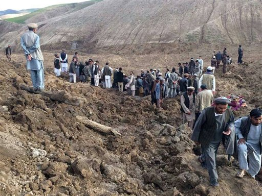 Afghans search for survivors after a landslide buried their village Friday in Badakhshan province, northeastern Afghanistan.