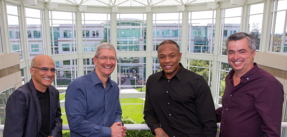 From left, music entrepreneur and Beats Electronics co-founder Jimmy Iovine, Apple CEO Tim Cook, Beats co-founder Dr. Dre, and Apple Senior Vice President Eddy Cue pose together at Apple headquarters in Cupertino, Calif., Wednesday. Apple announced that it has struck a deal to buy Beats, a headphone and music streaming specialist. The Associated Press/Apple