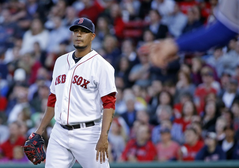 Boston Red Sox starting pitcher Felix Doubront watches a two-run homer by Toronto Blue Jays' Edwin Encarnacion stay fair in the third inning of a baseball game at Fenway Park in Boston, Tuesday, May 20, 2014. Fenway Park