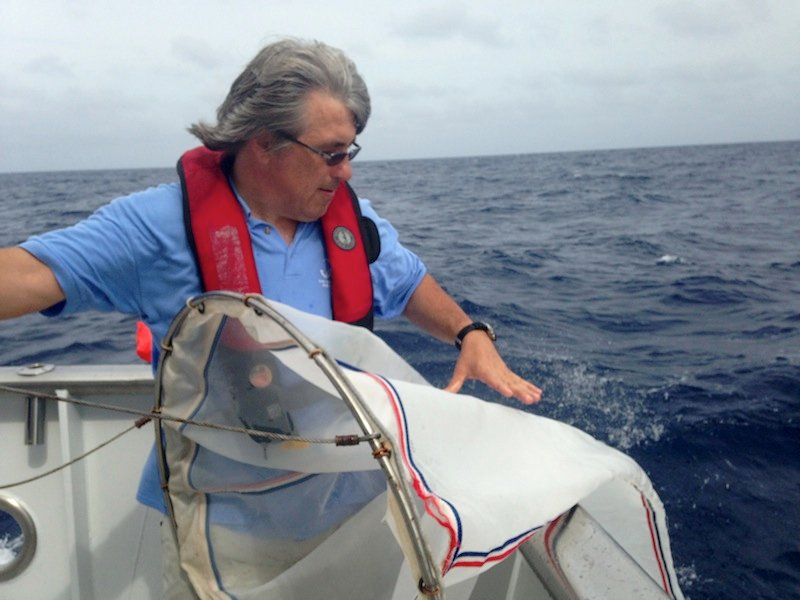 University of Florida neurobiologist Leonid Moroz pulls a net from the Gulf Stream off the coast of Florida in March to examine invertebrate species headed for his unique floating laboratory.