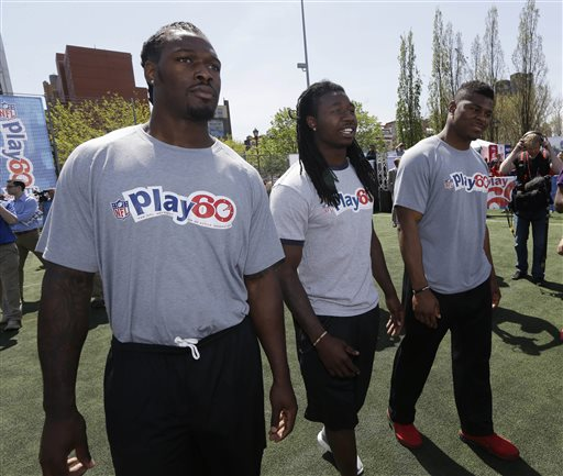 "South Carolina's Jadeveon Clowney, left, Clemson's Sammy Watkins, center, and Buffalo's Khalil Mack participate in an NFL event in New York Wednesday. Clowney says of waiting for the NFL draft starting Thursday night: ""I've been tired of it. I wish the draft was two or three weeks ago."""
