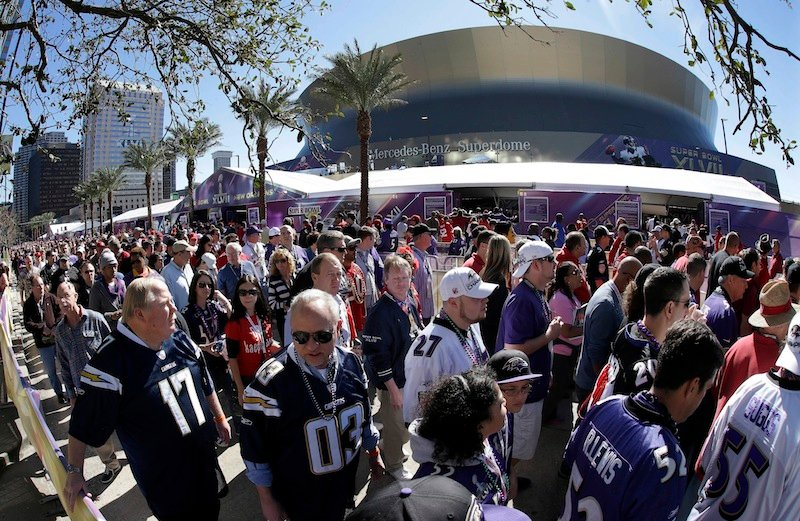 Fans line up to enter the Superdome in New Orleans before Super Bowl XLVII between the San Francisco 49ers and the Baltimore Ravens. NFL owners will vote Tuesday on the site of the 2018 Super Bowl, choosing among New Orleans, Indianapolis and Minneapolis.