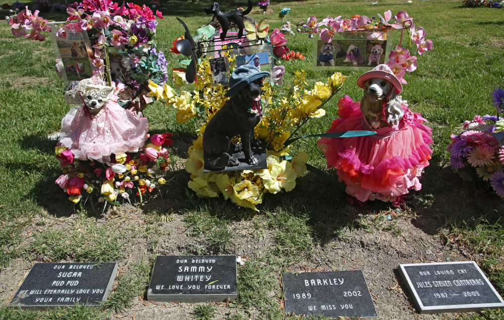 Statues memorialize family pets at the Los Angeles Pet Cemetery in Calabasas, Calif. The Associated Press