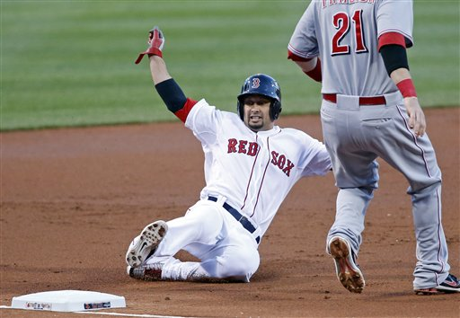 Shane Victorino slides into third base during the first inning against the Cincinnati Reds Wednesday. The Red Sox won, 4-3. Fenway Park