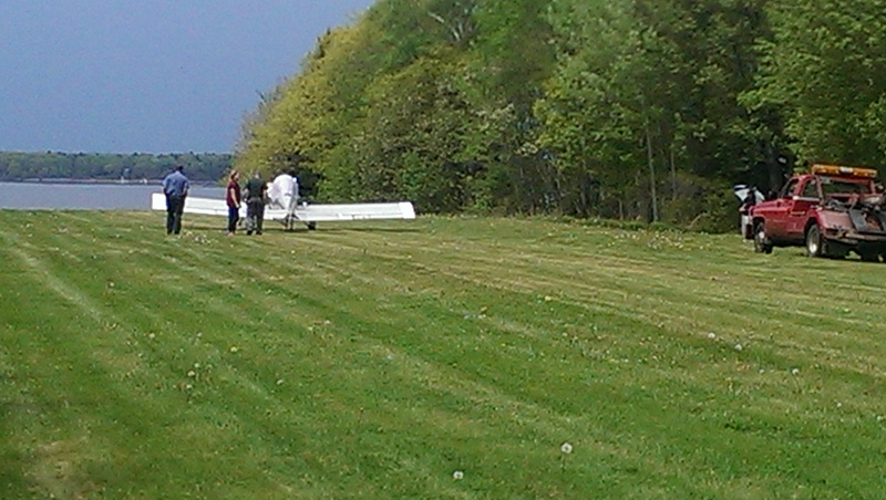 Plane in Harpswell at the end of a grass landing strip.
