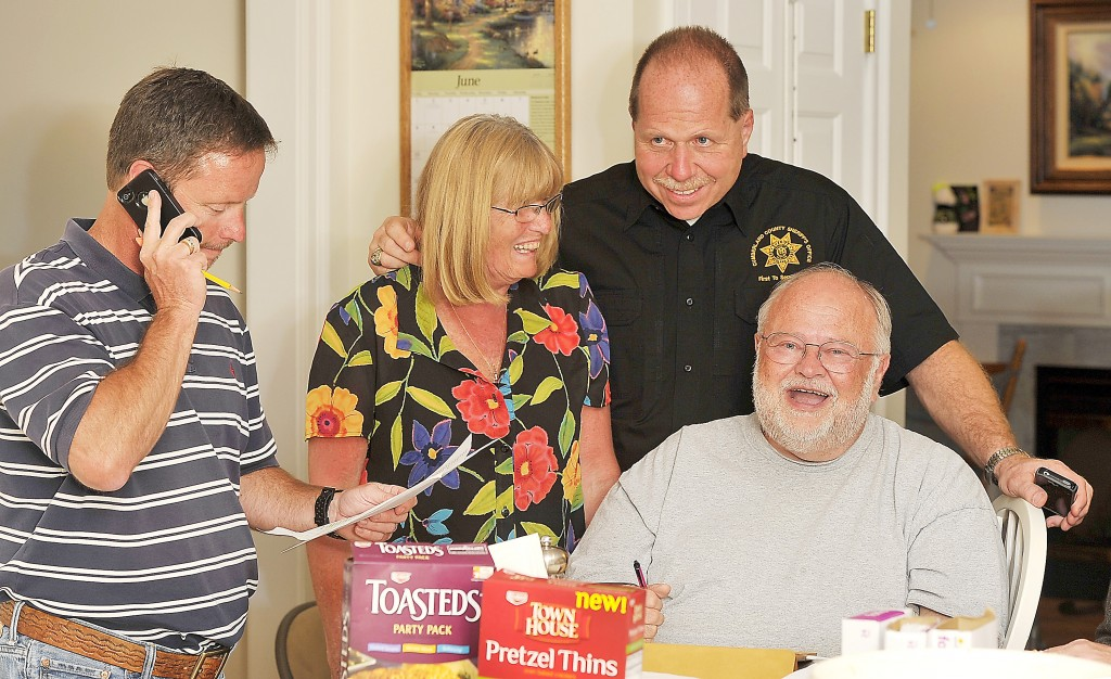 Dennis Hersom, left, Sheriff Kevin Joyce's campaign manager, calls in for early results as Penny Joyce, Joyce, center, and Richard Braus react to early returns showing Joyce to be leading Tuesday.