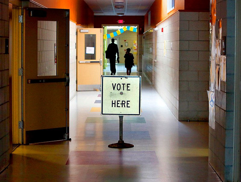 East End neighbors enter the polling area to vote at the East End Community School in Portland on Tuesday during the primary elections. Tim Greenway/Staff Photographer