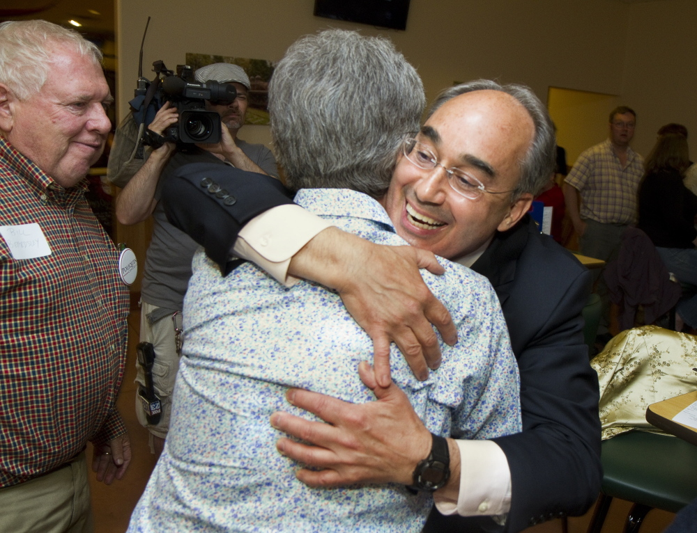Candidate for Congress Bruce Poliquin hugs friend and supporter Betsy Beardsley as the candidate arrives at Dysarts Broadway in Bangor on Tuesday. Carl D. Walsh/Staff Photographer