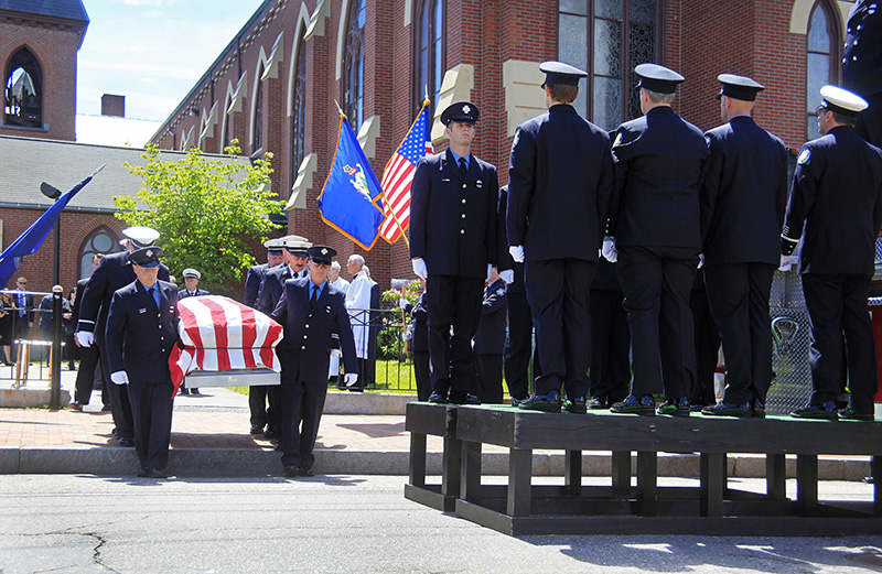 The casket carrying Portland Fire Capt. Michael Kucsma is escorted out of the Cathedral of the Immaculate Conception following his funeral service Saturday. Jill Brady/Staff Photographer