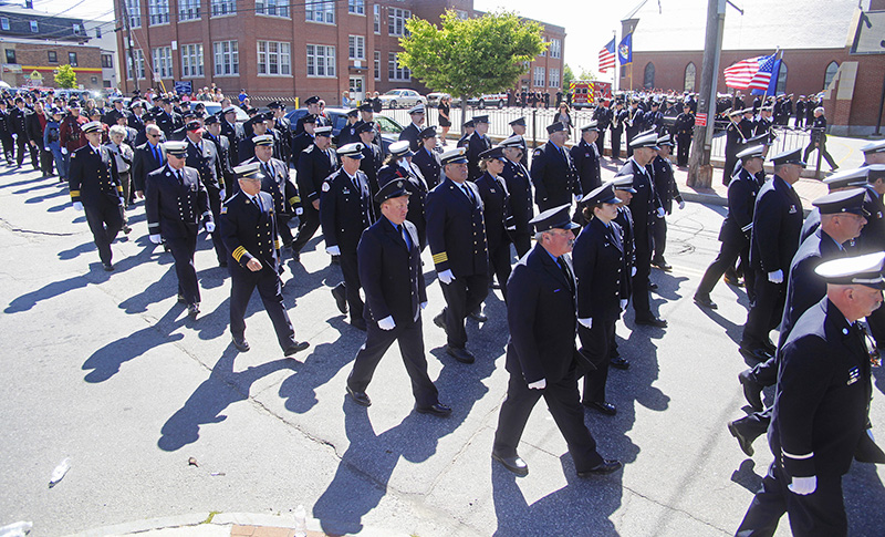 Firefighters from near and far march into the funeral service for Portland Fire Capt. Michael Kucsma at the Cathedral of the Immaculate Conception in Portland Saturday. Jill Brady/Staff Photographer