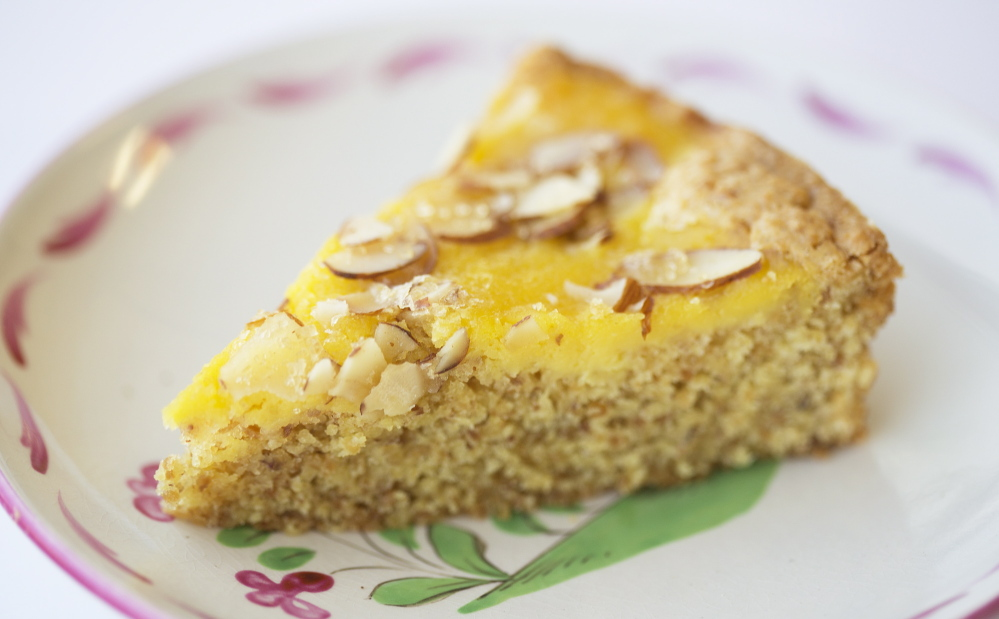 When life – or a generous colleague – gives you lots of eggs, try this lemon curd almond cake. Yoon S. Byun/Staff Photographer