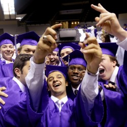 Shawn Patrick Ouellette/Staff Photographer Thoalfakar Alsaady takes a selfie with some of his Deering High School classmates prior to graduation Thursday.