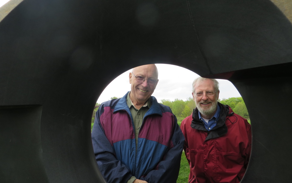 """Mike Iveson of Buckfield and Al Daniels of Norway enjoy the sculpture exhibit at Gilsland Farm's opening reception for """"A Celebration of Art and Nature."""" The installation by art dealer June LaCombe is in place through September. Photos by Amy Paradysz"""