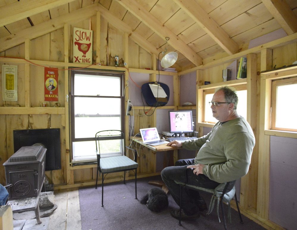 Crash Barry in the writing studio that he built a few hundred yards from his home in Oxford County that is made of wood milled from trees that the writer felled himself. John Patriquin/Staff Photographer