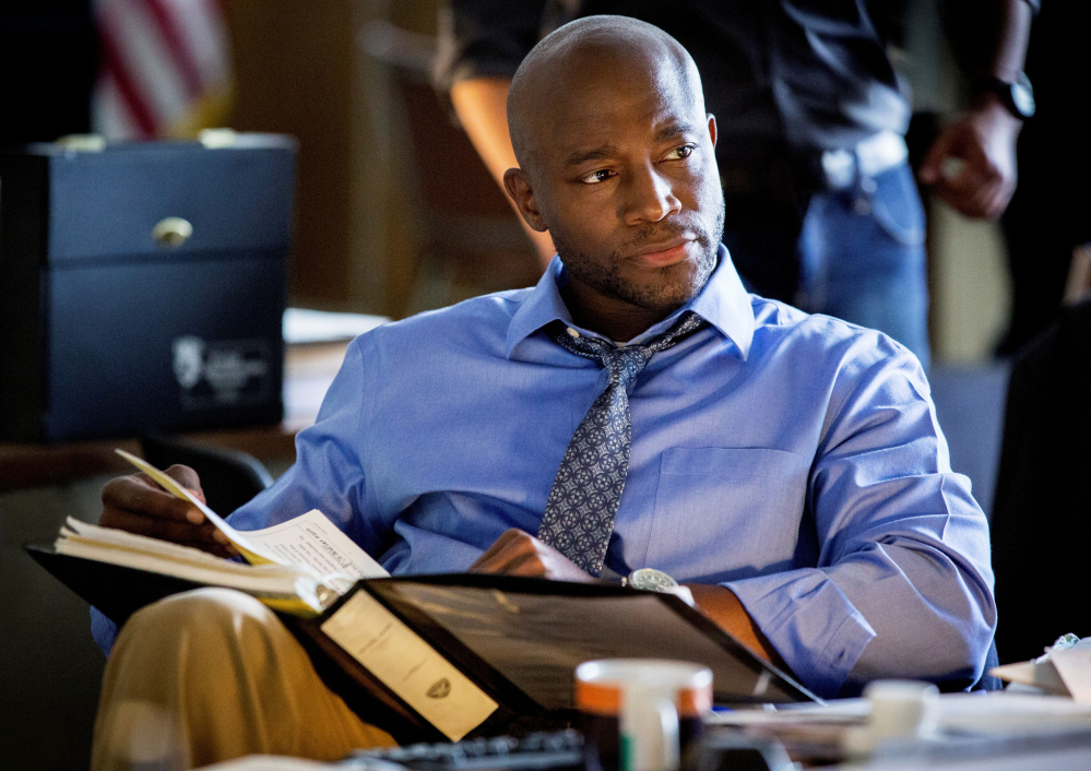 "The Associated Press/TNT This photo released by TNT shows Taye Diggs in a scene from the pilot for ""Murder in the First."" Diggs stars as a San Francisco police detective in the drama that also stars Kathleen Robertson and debuts Monday, June 9, 2014."