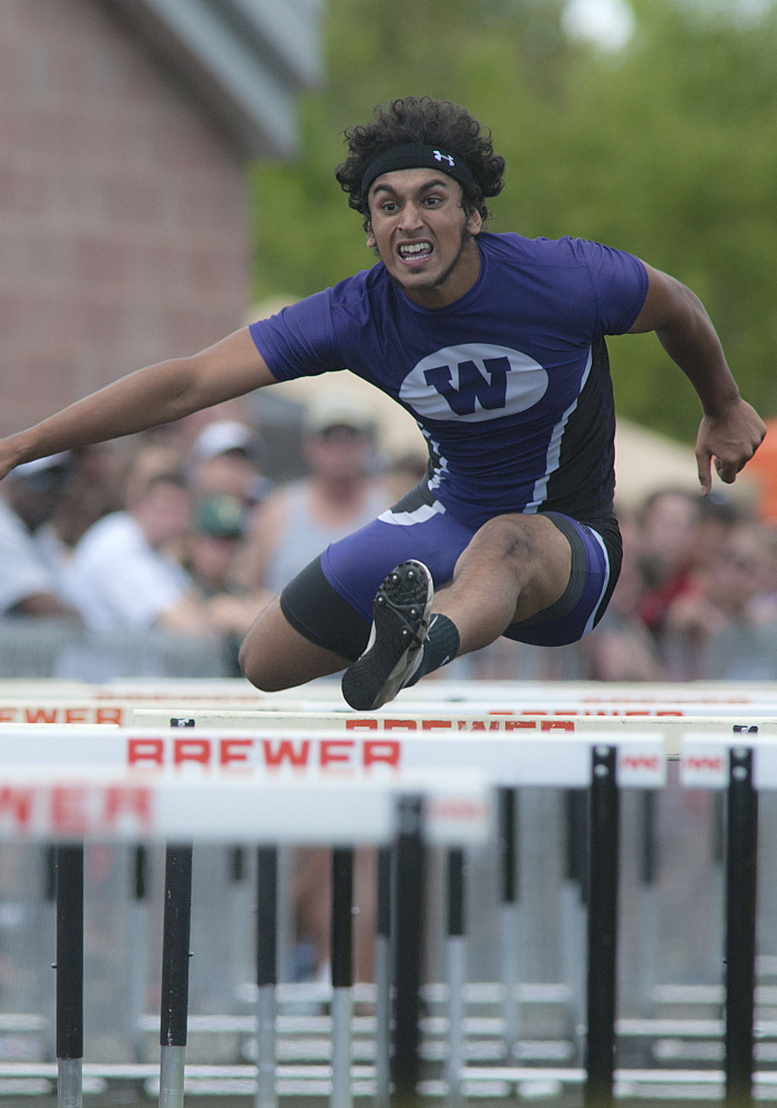 Michael C. York/Special to the Telegram Waterville's Shahzaib Khan, competes in the 110 meter hurdles in the State Class B track meet