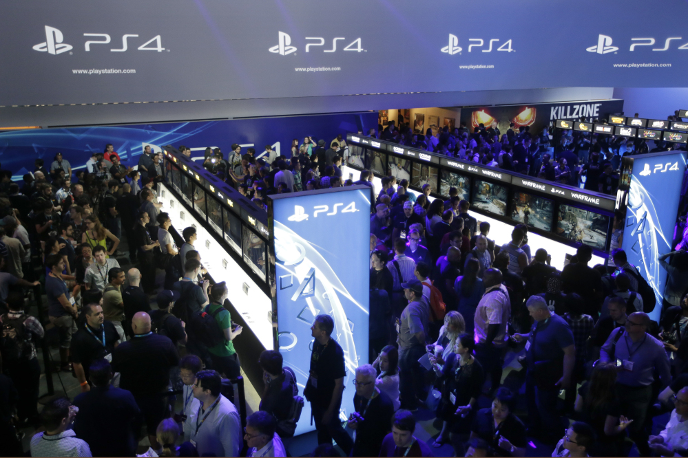 The Associated Press In this June 11, 2013 file photo, show attendees play video games on the new Sony PlayStation 4 at the Sony booth during the Electronic Entertainment Expo, in Los Angeles.