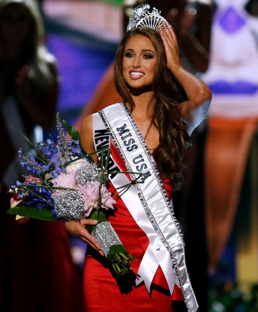 Miss Nevada USA Nia Sanchez adjusts her crown after being crowned the new Miss USA in Baton Rouge, La., on Sunday. The Associated Press
